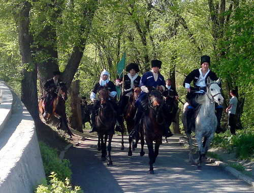 "Participants of equestrian march ascend to the Stela of Nations' Friendship on the Day of Circassian Flag, Karachay-Cherkessia, April 25, 2012. Photo by Svetlana Nosova for the ""Caucasian Knot"""