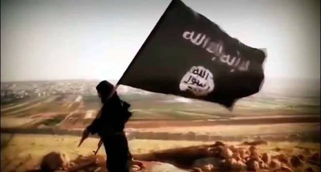"Flag of ""Islamic State"" (IS was recognized as a terrorist organization and banned in Russia) . Фото: VostockPhoto http://www.vostock-photo.com/"
