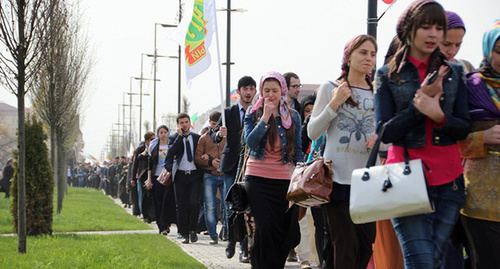 "A students column marches to the square near the mosque. Photo by Magomed Magomedov for the ""Caucasian Knot"""
