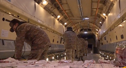 Loading of humanitarian aid on IL-76 plane to be transported from Armenia to Syria. Screenshot of video: https://ru.armeniasputnik.am/video/20170214/6407542/il-76-vezet-gumanitarnuyu-pomoshch-bratskoj-sirii.html