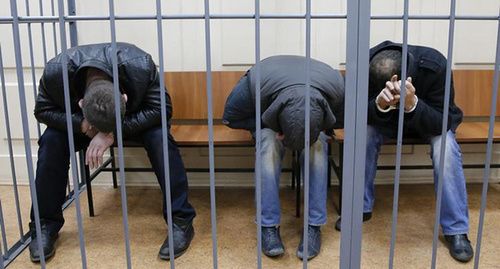 The defendants in Boris Nemtsov's murder case in the courtroom. Photo by Maxim Shemetov, REUTERS