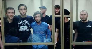"The defendants in the Caliphate case Islam Shogenov, Kantemir Zheldashev, Ruslan Kipshiev, Zaur Tekuzhev, Ruslan Zhugov, Oleg Miskhozhev, and Arthur Karov (to the right). Photo courtesy of Ramzan Uzuev for the ""Caucasian Knot"""