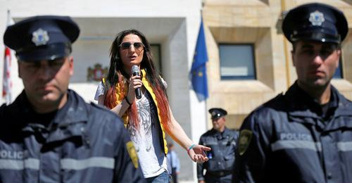 LGBT activist surrounded by policemen delivers speech, Tbilisi, May 2017. Photo: REUTERS/David Mdzinarishvili