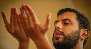 "A praying man. Photo by Aziz Karimov for the ""Caucasian Knot"""