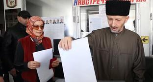 Mufti of Dagestan Ahmad Haji Afandi Abdulaev at Russian presidential election. Screenshot of the video by the user Novosti https://www.youtube.com/watch?v=4d6yablv8YQ
