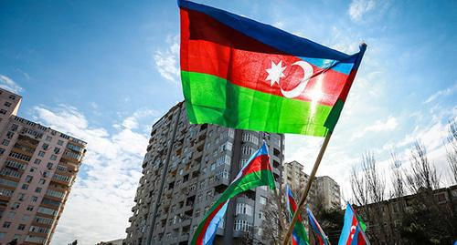 "The flag of Azerbaijan at the rally. Photo by Aziz Karimov for the ""Caucasian Knot"""
