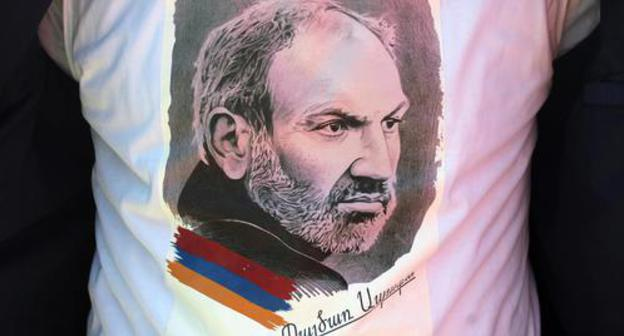 "One of the protesters in Yerevan, wearing a T-shirt with a photo of Nikol Pashinyan, the leader of the ""velvet"" revolution. Photo by Tigran Petrosyan for the ""Caucasian Knot"""