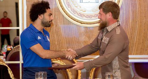 "Ramzan Kadyrov congratulates Mohamed Salah on awarding him the title of honorary citizen of Chechnya. Photo by the press service of the head of Chechnya, Ramzan Kadyrov's official page on ""VKontakte"" social network https://vk.com/ramzan?z=photo279938622_456259104%2Fwall279938622_271947"