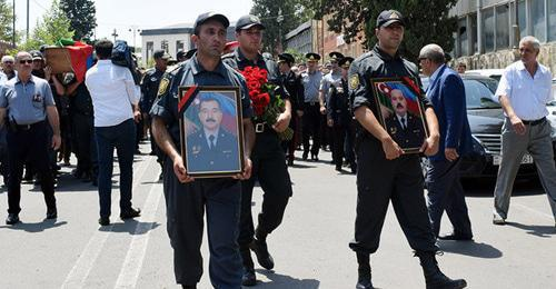 A mourning ceremony for the policemen killed in clashes during the protest action in the city of Ganja. Photo © Sputnik / İlham Mustafa