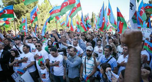 "Participants of the rally near the  monument of M. E. Rasulzade in the Novkhani village. Photo by Aziz Karimov for the ""Caucasian Knot"""