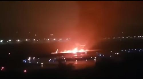 Burning plane in Sochi airport. Screenshot from video: https://youtu.be/W94S9Zo40RQ