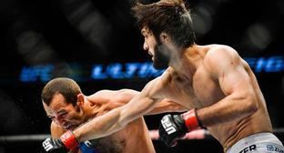 Zubair Tukhugov (from the right) during his featherweight fight with Ernest Chavez of USA at the Ultimate Fighting Championship (UFC) gala at the Globe Arena in Stockholm, October 4, 2014. Photo: REUTERS / Anders Wiklund