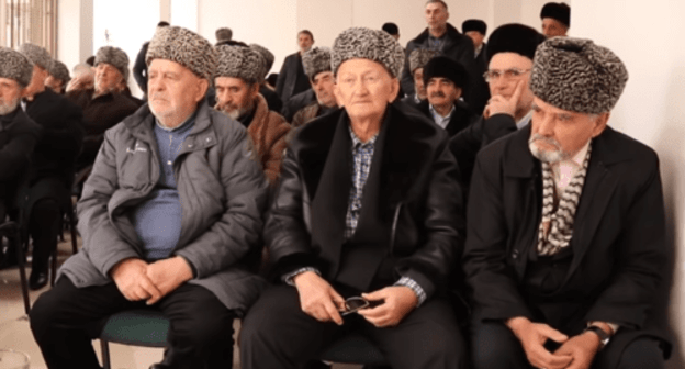 "Members of the Council of Teips of the Ingush People listening to the ""Appeal to the leadership and people of the Chechen Republic"". Screenshot from the video appeal dated December 7 2018. https://youtu.be/waLyRPxTXQM"