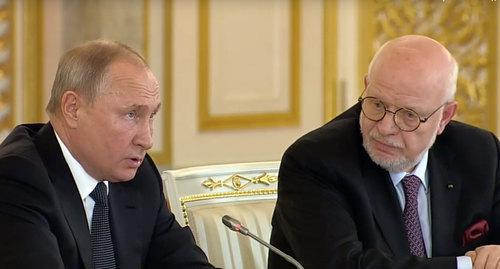 Vladimir Putin (on the left) and Mikhail Fedotov at the session of the Human Rights Council http://president-sovet.ru/presscenter/news/read/5119/