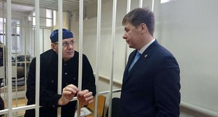 "Oyub Titiev and his advocate at the court. Photo courtesy of the Human Rights Centre ""Memorial"""