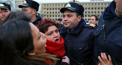 "Policemen prevented activists from marching in protest of violence against women. Baku, March 8, 2019. Photo by Aziz Karimov for the ""Caucasian Knot"""