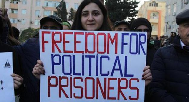Rally participant in Baku demand to release political prisoners. Photo by Aziz Karimov for the Caucasian Knot