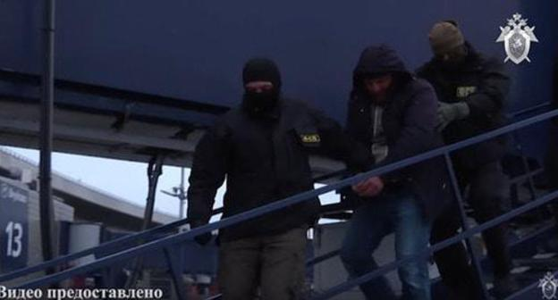 Detained Magomed Nurov (centre). Screenshot from video posted by the Investigative Committee of the Russian Federation, https://www.youtube.com/watch?time_continue=3&v=o6iwQMehugM