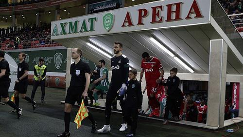 "Football players enter the field at the ""Akhmat Arena"" Stadium on April 13, 2019. Photo by the press service of the ""Lokomotiv"" FC ttps://www.fclm.ru/ru/publications/news/19888"