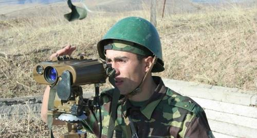 A soldier of the army of Nagorno-Karabakh at the military positions. Photo by the Ministry of Defence for Nagorno-Karabakh http://www.nkrmil.am