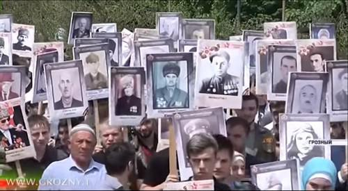 "Participants of the ""Immortal Regiment"" action in Grozny, May 9, 2019. Screenshot from video broadcasting by 'Grozny' TV Channel, https://www.youtube.com/watch?v=3pjVOi_3Bjo"