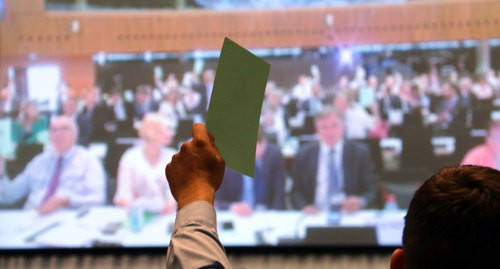 Voting during the session of the Parliamentary Assembly (PA) of the OSCE (Organisation for Security and Cooperation in Europe). Photo by the press service of the PA OSCE https://www.flickr.com/photos/oscepa/albums/72157709462707676