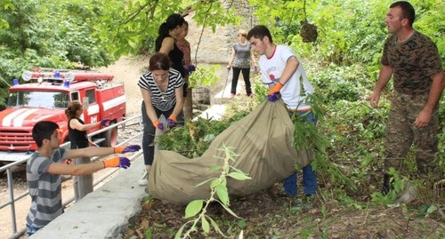 "Residents of Nagorno-Karabakh doing a volunteer clean-up program in the village of Tyak. Photo by Alvard Grigoryan for the ""Caucasian Knot"""
