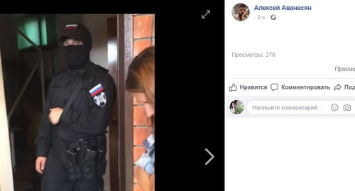 "Rosgvardia officer during search in the office of the ""Ecological Watch for North Caucasus"". Screenshot of the Facebook post by Alexei Avanesyan, http://www.facebook.com/100005066893432/videos/pcb.1254162881429263/1254177024761182/?type=3&theater"