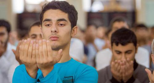 "A young man during a prayer. Photo by Aziz Karimov for the ""Caucasian Knot"""