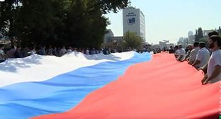 Celebration of the Day of the National Flag of Russia in Chechnya. Screenshot from video by 'Grozny' TV Company