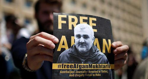 A poster with Afghan Mukhtarly's photo. Photo: REUTERS/David Mdzinarishvili