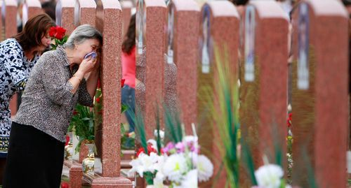 Grieving women at a cemetary in the town of Beslan on September 3, 2010. Photo: REUTERS / Kazbek Basaev