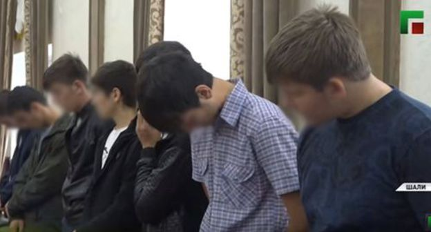 Young men apologize for their Internet posts on air of the Chechen TV. Screenshot from video posted by the Chechen TV Channel at https://www.youtube.com/watch?v=X8yS1QCjrpc