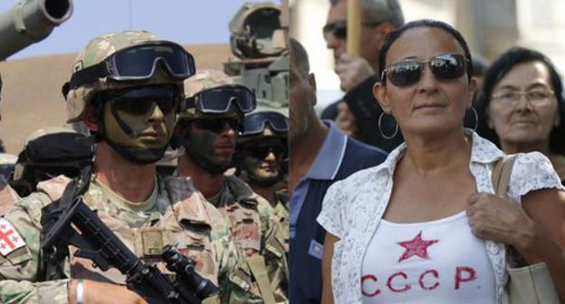 "Noble Partner 2017 military exercises and a woman wearing a T-shirt with the inscription ""USSR"". Collage by the ""Caucasian Knot"". Photo: REUTERS/David Mdzinarishvili, Inna Kukudjanova for the ""Caucasian Knot"""