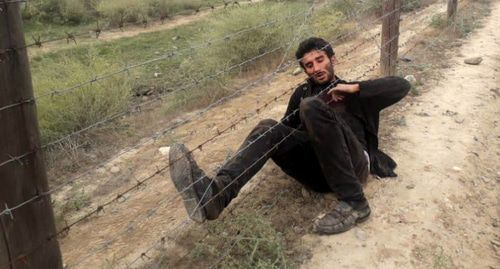 A man who tried to illegally cross a border with Iran. Photo by the press service of the State Border Guard Service of Azerbaijan http://dsx.gov.az/xeber/897