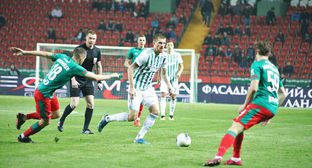 "The match of the ""Akhmat"" Football Club (FC) with the Moscow ""Lokomotiv"" FC in front of the half-empty stands. Photo by the press service of the ""Akhmat"" FC"