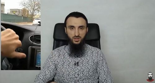 Tumso Abdurakhmanov shows a video posted by Islam Nukhanov. Screenshot of the video on Abdurakhmanov's YouTube channel https://www.youtube.com/channel/UCgggK05bEJ1BAQ2NTUn4igA