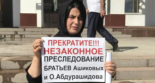 "Khadijat, Omar Abdurashidov's sister, held a picket in the center of Makhachkala. July 4, 2019. Photo by Patimat Makhmudova for the ""Caucasian Knot"""