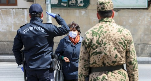"A police officer stops a woman in a street in Baku during the quarantine regime. Photo by Aziz Karimov for the ""Caucasian Knot"""