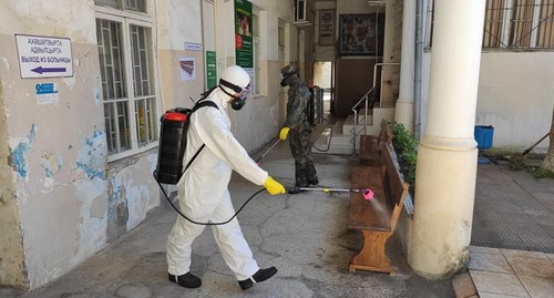 Worker in a protective suit is conducting disinfection, Abkhazia. Photo: press service of the Ministry for Emergencies of Abkhazia