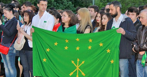 "Participants of a mourning rally on the 151st anniversary of the end of the Caucasian War, holding a Circassian flag. Moscow, May 21, 2015. Photo by Karina Gadjieva for the ""Caucasian Knot"""