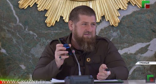 "Ramzan Kadyrov shows the message about the death of the medic of the Gudermes Central District Hospital at the meeting of the Operations Group. Screenshot of the video by the ""Grozny"" ChGTRK (Chechen State TV and Radio Company) https://www.youtube.com/watch?v=nfMDCHmm9I4&feature=emb_title"