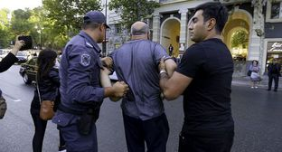 "The detention of an activist in Baku. Photo by Aziz Karimov for the ""Caucasian Knot"""