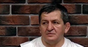 "Abdulmanap Nurmagomedov. Screenshot of the video by ""Vremya Sporta"" https://www.youtube.com/watch?v=HWyclHTd89o"
