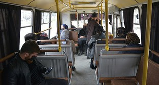 Chechen residents in a bus. Photo: REUTERS/Ramzan Musaev