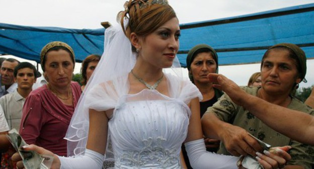 A wedding in the Caucasus. Photo: Reuters /Thomas Peter (RUSSIA)