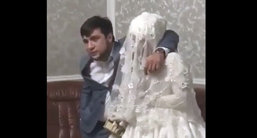 Resident of Dagestan and his bride. Screenshot: https://vk.com/golos_dagestan?w=wall-74219800_766567