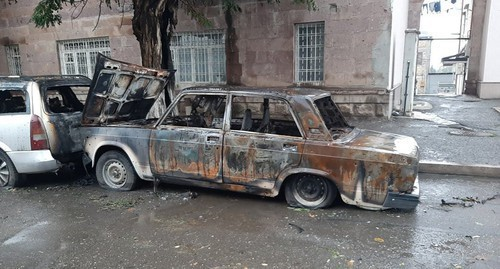 "A smashed car on a street in Stepanakert, October 19. Photo by Alvard Grigoryan for the ""Caucasian Knot"""
