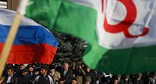 The flags of Russia and Ingushetia at the rally in Magas, March 17, 2020. Photo: REUTERS/Maxim Shemetov