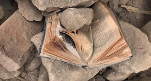 "A book under the rubble of a home. November 2020. Photo by Alvard Grigoryan for the ""Caucasian Knot"""